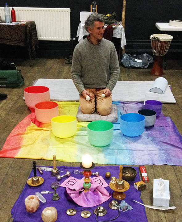 Tony prepares to do a sound bath with crystal singing bowls in episode 31 Vibrations of Tesla on The Gray Escape